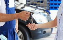 mechanic handing key to customer